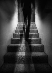 shadowy man walking up stairs