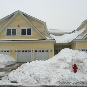 Snow in front of house