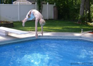 Boy diving into swimming pool